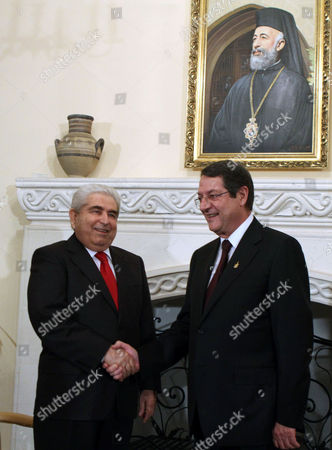 New Cypriot President Nicos Anastasiades (r) Shakes Hands with Outgoing President Demetris Christofias (l) at the Presidential Palace in Nicosia Cyprus 28 February 2013 Anastasiades was Elected President of Cyprus 24 February 2013 and Will Serve a Five-year Term in Office Cyprus Nicosia