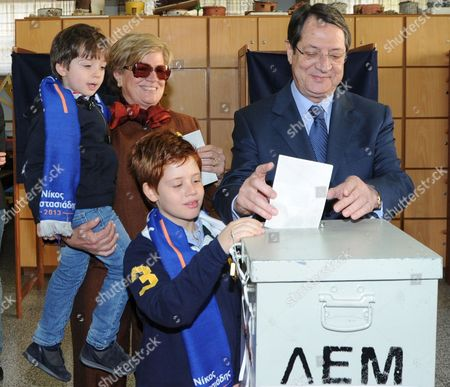 Cypriot Presidential Candidate Nicos Anastasiades Accompanied by His Grandson Andy Casts His Vote During Presidential Elections in Limassol Cyprus 17 February 2013 Voting in Cyprus is Compulsory by Law There Are a Total of Eleven Candidates But the Battle Appears to Between Nicos Anastasiades Stavros Malas and George Lillikas Incumbent President Demetris Christofias is not Seeking Re-election Cyprus Limassol