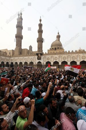 Egyptians Muslims Brotherhood Supporters Hold Egyptian and Palestinian Flags As They Demonstrate to Condemn Israel's Air Strikes on the Gaza Strip at Al Azhar Mosque in Cairo Egypt 16 November 2012 Thousands of Egyptians Demonstrated Against the Israeli Attacks Following Friday Prayers in the Al Azhar Mosque in Cairo As President Mohammed Morsi Said on 16 November That Egypt 'Will not Leave Gaza on Its Own ' After He Sent His Prime Minister Hisham Qandil to the Enclave in a Show of Solidarity Egypt Cairo