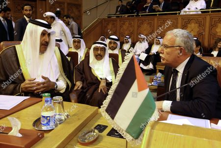 Stock Photo of Qatari Prime Minister and Foreign Minister Sheikh Hamad Bin Jassim Bin Jabr Al-thani (l) and Palestinian Foreign Minister Reyad Almalki (r) Attend the Arab League Foreign Ministers Emergency Meeting Held at the League's Headquarters in Cairo Egypt 17 November 2012 Arab League Foreign Ministers Reportedly Comdemned the Israeli Attacks on the Gaza Strip Egypt Cairo