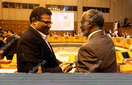 Sudanese Foreign Minister Ali Karti (r) and Tunisian Foreign Minister Rafik Abdessalem (l) Greet Each Other As They Attend the Arab League Foreign Ministers Emergency Meeting Held at the League's Headquarters in Cairo Egypt 17 November 2012 Arab League Foreign Ministers Comdemned the Israeli Attacks on the Gaza Strip Egypt Cairo