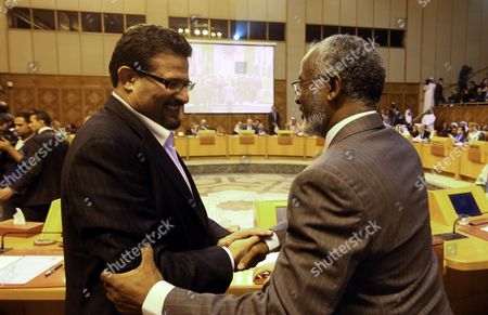 Sudanese Foreign Minister Ali Karti (r) and Tunisian Foreign Minister Rafik Abdessalem (l) Greet Each Other As They Attend the Arab League Foreign Ministers Emergency Meeting Held at the League's Headquarters in Cairo Egypt 17 November 2012 Arab League Foreign Ministers Reportedly Comdemned the Israeli Attacks on the Gaza Strip Egypt Cairo