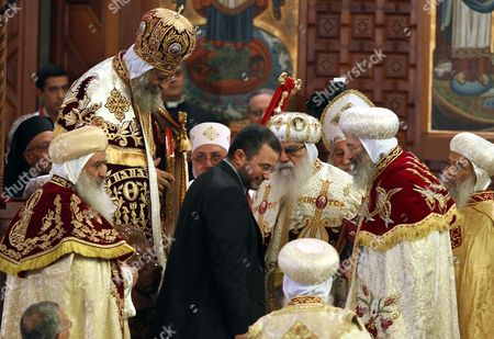 Egyptian Prime Minister Hisham Qandil (c) Leaves After He Congratulated the New Pope Tawadros Ii (2-l) Leader of the Egyptian Coptic Orthodox Church During the Enthronement Ceremony at the St Mark Cathedral in Abbasiya Cairo Egypt 18 November 2012 Pope Tawadros Ii the 118th Pope of the Coptic Orthodox Church Will Lead the Largest Christian Community in the Middle East Thought to Make Up Around 10 Per Cent of Egypt's Muslim-majority 90 Million Population Egypt Cairo