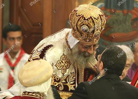 Egyptian Prime Minister Hisham Qandil (r) Congratulates the New Pope Tawadros Ii (c) Leader of the Egyptian Coptic Orthodox Church During the Enthronement Ceremony at the St Mark Cathedral in Abbasiya Cairo Egypt 18 November 2012 Pope Tawadros Ii the 118th Pope of the Coptic Orthodox Church Will Lead the Largest Christian Community in the Middle East Thought to Make Up Around 10 Per Cent of Egypt's Muslim-majority 90 Million Population Egypt Cairo