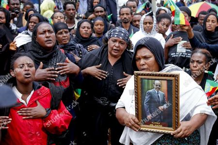 Mourners Hold a Portrait of the Late Ethiopian Prime Minister Meles Zenawi at His Funeral in Addis Ababa Ethiopia 02 September 2012 Zenawi who was Praised For the Country's Economic Growth But Criticised For Suppresion of Dissidents Died at a Hostpital in Belgium at the Age Pf 57 on 20 August 2012 Tens of Thousands of Ethiopians and Some 15 Heads of State Attended the Funeral to Pay Their Respects Ethiopia Addis Ababa