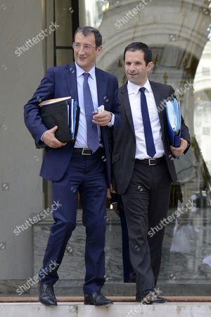 Stock Image of French Junior Minister For Cities Francois Lamy (l) and French Junior Minister For Social and Solidarity Economy Benoit Hamon (r) Leave the Elysee Presidential Palace After the Weekly Cabinet Meeting in Paris 01 August 2012 France Paris