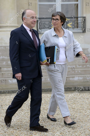 French Eu Affairs Minister Bernard Cazeneuve (l) and French Sports Minister Valerie Fourneyron (r) Leave the Elysee Presidential Palace After the Weekly Cabinet Meeting in Paris 01 August 2012 France Paris
