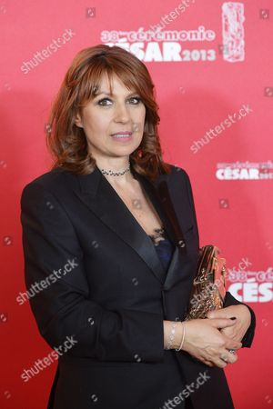Stock Photo of French Actress Valerie Benguigui Poses with Her Best Supporting Actress Award For Her Role in 'Le Prenom' in the Press Room During the 38th Annual Cesar Awards Ceremony Held at the Chatelet Theatre in Paris France 22 February 2013 France Paris