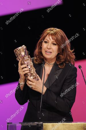 Stock Picture of French Actress Valerie Benguigui Receives the Best Supporting Actress Award For Her Role in 'Le Prenom' During the 38th Annual Cesar Awards Ceremony Held at the Chatelet Theatre in Paris France 22 February 2013 France Paris