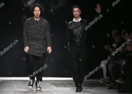 Designers Eri and Philip Chu Take to the Catwalk After Their Show For Ground Zero Fashion House During the Paris Fashion Week in Paris France 26 February 2013 the Presentation of the Ready to Wear Collections Fall / Winter 2013-2014 Runs From 26 February to 03 March France Paris