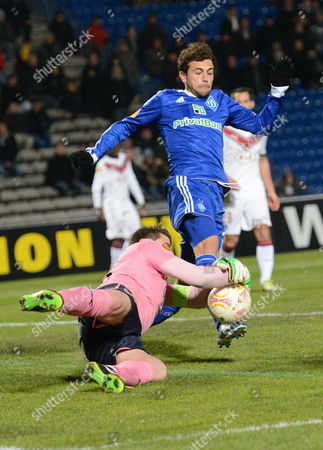Goalkeeper Cedric Carrasso (l) of Bordeaux Stops the Ball with Admir Mehmedi (r) of Fc Dynamo Kiev During the Uefa Europa League Round of 32 Second Leg Soccer Match Between Girondins Bordeaux and Fc Dynamo Kyiv in Bordeaux France 21 Febrary 2013 France Bordeaux