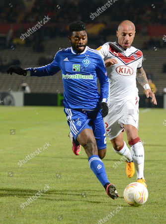 Julien Faubert (r) of Bordeaux Vies For the Ball with Lukman Haruna (l) of Fc Dynamo Kiev During the Uefa Europa League Round of 32 Second Leg Soccer Match Between Girondins Bordeaux and Fc Dynamo Kyiv in Bordeaux France 21 Febrary 2013 France Bordeaux