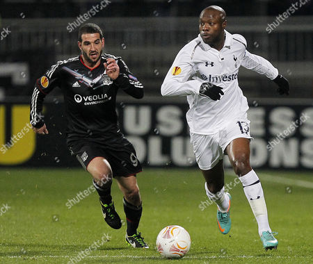 William Gallas (r) of Tottenham Vies For the Ball with Lisandro Lopez (l) of Olympique Lyon During the Uefa Europa League Round of 32 Second Leg Soccer Match Between Olympique Lyon and Tottenham Hotspur at Gerland Stadium in Lyon France 21 February 2013 France Lyon