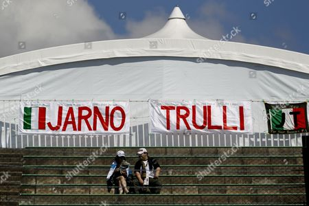 Formula One Fans Sit on the Stands Beneath a Large Banner with the Name of Former Formula One Driver Jarno Trulli at the Suzuka Circuit in Suzuka Japan 04 October 2012 the Japan Formula One Grand Prix Will Be Held on 07 October Japan Suzuka