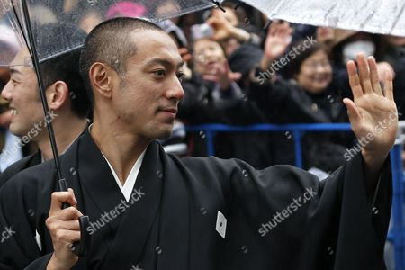 Kabuki Actor Ebizo Ichikawa Waves to Fans As He Parades Through a Main Street in the Ginza District of Tokyo Japan 27 March 2013 Ahead of the Opening of the New Kabuki-za Theatre Some 60 Kabuki Actors Participated in the Parade to Commemorate the Opening of the Reconstructed Theatre Which Will Officially Open to the Public with a Variety of Facilities and Attractions on 02 April 2013 Japan Tokyo