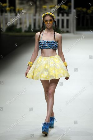 A Model Presents a Creation by Japanese Designer Chinatsu Wakatsuki For Her Label Wc During the Mercedes-benz Fashion Week in Tokyo Japan 15 October 2012 the Presentation of the Spring / Summer 2013 Collections Runs From 13 to 20 October Japan Tokyo