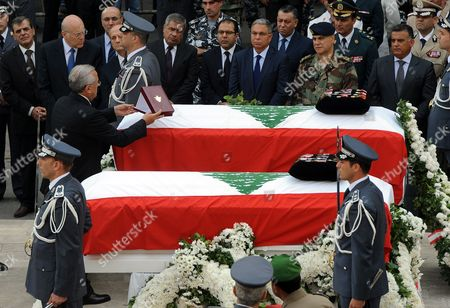 Lebanese President Michel Sleiman (l) Places a Honorary Shield on the Coffin of the Head of the Information Branch in Lebanon's Internal Security Forces (isf) Wissam Al-hassan During an Official Ceremony at the Headquarters of the Internal Security Forces in Beirut Lebanon 21 October 2012 Hassan was Killed on 19 October in a Huge Explosion That Rocked in the Achrafiyeh Christian Residential Area Which Left at Least Eight Dead and 78 Wounded in the First Such Attack in the Lebanese Capital Since 2008 Lebanon Beirut