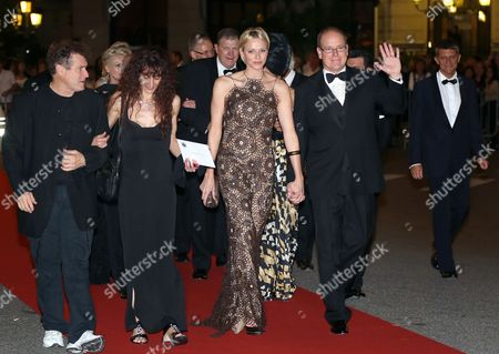 Prince Albert Ii of Monaco (r) Arrives with His Wife Princess Charlene (2-r) and British-born Musician From South Africa Johnny Clegg (l) and His Wife at the Gala South Africa Night at the Opera Garnier in Monaco 29 September 2012 All the Benefit Will Be Go to Princess Charlene Foundation Monaco Monaco