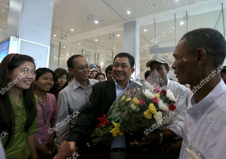 Maung Maung Aka Pyithit Nyunt Wai (c) Secretary of the Free Trade Unions of Burma (ftub) Receives Flowers and Greets His Friends As He Arrives at Yangon International Airport Yangon Myanmar 04 September 2012 Reports State That Myanmar Government Has Removed 2 082 Names From Its 6 165-person Blacklist Including Alexander and Kim Aris Sons of Myanmar Democracy Leader Aung San Suu Kyi Myanmar Yangon