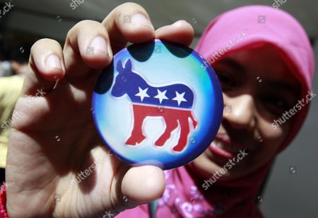 Filipino Omar Natasha Holds Her Democratic Election Pin After Casting Her Vote During a Mock Election at an Election Watch in the Lobby of a Shopping Mall in Eastern Manila Philippines 07 November 2012 the Event was Set Up by the Us Embassy to Monitor the Presidential Race Filipinos who Have a Long Love-hate Affair with Their Former American Colonial Masters Were Also Excited About the Prospects of the Re-elected Obama Presidency Philippines Manila