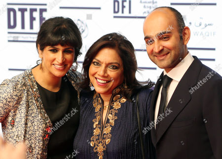 Indian Director Mira Nair (c) Reluctant Fundamentalist Author Mohsin Hamid (r) From Pakistan and Co-author Saeeda Amin Bukhari (l) From Pakistan on the Red Carpet For the Gala Screening of 'The Reluctant Fundamentalist' During the 2012 Doha Tribeca Film Festival in Doha Qatar 17 November 2012 Qatar Doha