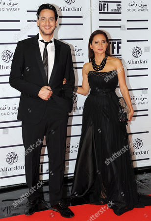 Egyptian Actor Khaled Abul Naga (l) and Actress Nelly Karim on the Red Carpet For the Gala Screening of 'The Reluctant Fundamentalist' During the 2012 Doha Tribeca Film Festival in Doha Qatar 17 November 2012 Qatar Doha