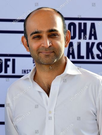 'Reluctant Fundamentalist' Author Mohsin Hamid From Pakistan Poses During the Photocall For the Movie 'Reluctant Fundamentalist' During Doha Tribeca Film Festival Opening Night in Doha Qatar 17 November 2012 Qatar Doha