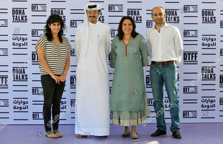 Indian Director Mira Nair (2r) Poses For Photographers with Doha Film Institute Ceo Film Abdul Azeez Al-khater (2l) 'Reluctant Fundamentalist' Author Mohsin Hamid (r) and Screenwriter Ami Boghani (l) During the Photocall For the Movie 'Reluctant Fundamentalist' During Doha Tribeca Film Festival Opening Night in Doha Qatar 17 November 2012 Qatar Doha
