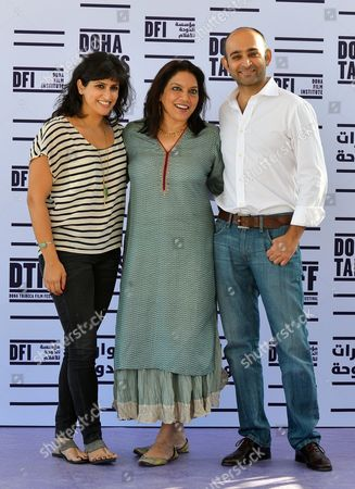 Indian Director Mira Nair (c) Poses For Photographers with the 'Reluctant Fundamentalist' Author Mohsin Hamid (r) and Screenwriter Ami Boghani (l) During the Photocall For the Movie 'Reluctant Fundamentalist' During Doha Tribeca Film Festival Opening Night in Doha Qatar 17 November 2012 Qatar Doha