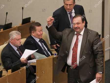 Gennady Gudkov (r) Reacts After Loosing His Parliamentary Mandate As Just Russia Parliamentary Faction Leader Sergei Mironov (l) Looks Through Papers During a Plenary Session of the State Duma Russia's Lower House of Parliament in Moscow Russia 14 September 2012 the State Duma Voted to Deprive 'Just Russia' Party Member Gennady Gudkov of His Deputy Mandate For According to Russian Prosecutor General's Office Numerous Violations of the Law by Involvement in Illegal Business Activity the Russian Investigative Committee Has Extended Till 23 September the Pre-investigation Check on Gudkov Russian Federation Moscow
