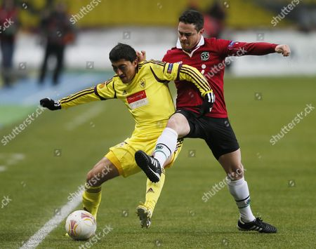 Manuel Schmiedebach (r) of Hanover 96 Vies For the Ball with Odil Ahmedov of Makhachkala During the Uefa Europa League Round of 32 Soccer Match in Moscow Russia 14 February 2013 Russian Federation Moscow