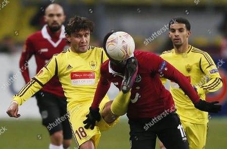 Didier Ya Konan (r) of Hannover 96 Vies For the Ball with Yuri Zhirkov (l) of Anzhi Makhachkala During the Uefa Europa League Soccer Match Between Anzhi Makhachkala and Hanover 96 at the Luzhniki Stadium in Moscow Russia 14 February 2013 Russian Federation Moscow