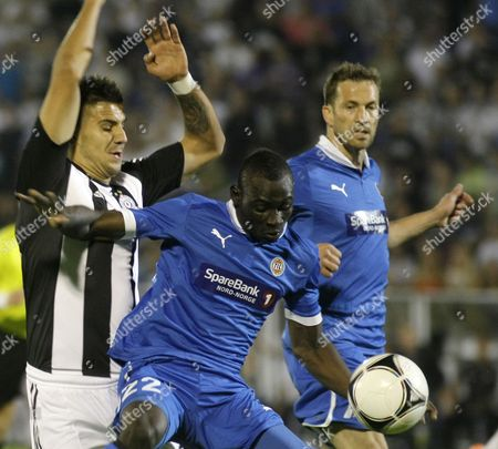 Saliou Ciss (c) of Tromso Vies For the Ball with Aleksandar Mitrovic (l) of Partizan Belgrade During Their Uefa Europa League Play Off Second Leg Soccer Match in Belgrade Serbia 30 August 2012 Serbia and Montenegro Belgrade