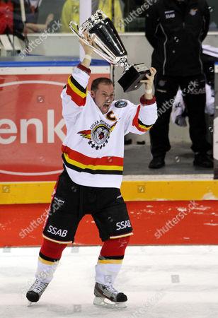 Stock Photo of Captain Chris Abbott of Lulea Hockey Celebrates After His Team Won the European Trophy Ice Hockey Final Match Between Lulea Hockey and Farjestad Bk in Bratislava Slovakia 16 December 2012 Slovakia (slovak Republic) Bratislava