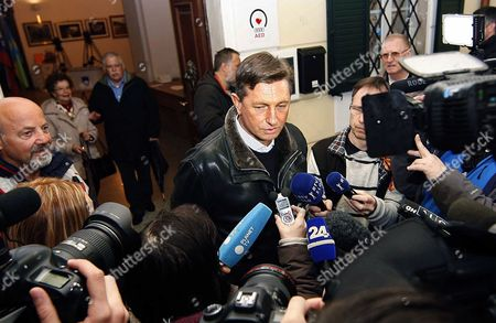 Presidential Candidate Borut Pahor of the Social Democratic Party Speaks to Reporters at a Polling Station in Sempeter Near Nova Gorica Slovenia 02 December 2012 Voting in the Slovenian Presidential Election Run-off - Between Favoured Challenger Borut Pahor and Incumbent Danilo Turk - Began 02 December at an Even Slower Pace Than in the First Round when the Final Turnout Dropped to a Record Low Latest Opinion Surveys Gave Pahor a Former Premier of the Social Democratic Party an Edge As Large As 70 Per Cent to the Independent Turk's Expected 30 Per Cent Voting Ends at 7 Pm (1800 Gmt) and Exit Poll Results Are Expected Shortly After That Slovenia Sempeter