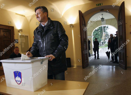 Presidential Candidate Borut Pahor (l) of the Social Democratic Party Poses For the Media Before Casting His Vote at a Polling Station in Sempeter Near Nova Gorica Slovenia 02 December 2012 Voting in the Slovenian Presidential Election Run-off - Between Favoured Challenger Borut Pahor and Incumbent Danilo Turk - Began 02 December at an Even Slower Pace Than in the First Round when the Final Turnout Dropped to a Record Low Latest Opinion Surveys Gave Pahor a Former Premier of the Social Democratic Party an Edge As Large As 70 Per Cent to the Independent Turk's Expected 30 Per Cent Voting Ends at 7 Pm (1800 Gmt) and Exit Poll Results Are Expected Shortly After That Slovenia Sempeter
