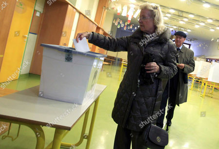 Voters Cast Their Ballots at a Polling Station in Ljubljana Slovenia 02 December 2012 Slovenians Began Voting on Sunday 02 December in a Presidential Election Run-off with Challenger Borut Pahor Tipped to Defeat Incumbent Danilo Turk Latest Opinion Surveys Gave Pahor a Former Premier of the Social Democratic Party an Edge As Large As 70 Per Cent to the Independent Turk's Expected 30 Per Cent Voting Ends at 7 Pm (1800 Gmt) and Exit Poll Results Are Expected Shortly After That Slovenia Ljubljana