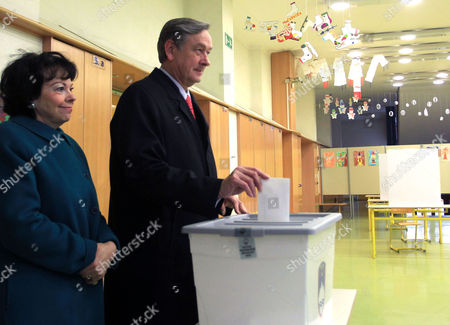 Slovenia's President Danilo Turk (2-l) is Accompanied by His Wife Barbara Turk (l) As He Casts His Ballot at a Polling Station in Ljubljana Slovenia 02 December 2012 Slovenians Began Voting on Sunday 02 December in a Presidential Election Run-off with Challenger Borut Pahor Tipped to Defeat Incumbent Danilo Turk Latest Opinion Surveys Gave Pahor a Former Premier of the Social Democratic Party an Edge As Large As 70 Per Cent to the Independent Turk's Expected 30 Per Cent Voting Ends at 7 Pm (1800 Gmt) and Exit Poll Results Are Expected Shortly After That Slovenia Ljubljana