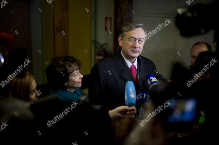 Slovenia's President Danilo Turk (cr) is Accompanied by His Wife Barbara Miklic Turk (cl) As He Speaks to Reporters After Casting His Ballot at a Polling Station in Ljubljana Slovenia 02 December 2012 Slovenians Began Voting on Sunday 02 December in a Presidential Election Run-off with Challenger Borut Pahor Tipped to Defeat Incumbent Danilo Turk Latest Opinion Surveys Gave Pahor a Former Premier of the Social Democratic Party an Edge As Large As 70 Per Cent to the Independent Turk's Expected 30 Per Cent Voting Ends at 7 Pm (1800 Gmt) and Exit Poll Results Are Expected Shortly After That Slovenia Ljubljana