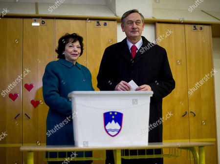 Slovenia's President Danilo Turk (r) is Accompanied by His Wife Barbara Miklic Turk (l) As He Casts His Ballot at a Polling Station in Ljubljana Slovenia 02 December 2012 Slovenians Began Voting on Sunday 02 December in a Presidential Election Run-off with Challenger Borut Pahor Tipped to Defeat Incumbent Danilo Turk Latest Opinion Surveys Gave Pahor a Former Premier of the Social Democratic Party an Edge As Large As 70 Per Cent to the Independent Turk's Expected 30 Per Cent Voting Ends at 7 Pm (1800 Gmt) and Exit Poll Results Are Expected Shortly After That Slovenia Ljubljana