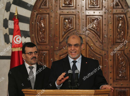 Former Prime Minister Hamadi Jebali (r) Speaks As New Prime Minister Ali Larayedh (l) Looks on During the Ceremony of Transfer of Power Between Two Prime Ministers at the Government Palace the Kasbah in Tunis Tunisia 14 Mars 2013 the New Government Which was Formed by Ennahda Pary and Two Small Secular Allies is Charged with Leading the Country out of the Month-long Crisis Caused by the Assassination of Opposition Politician Chokri Belaid in February Tunisia Tunis