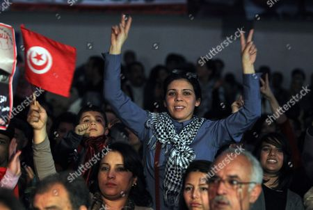A Tunisian Woman Flashes the Victory During Ceremony Marking 40 Days Since the Killing of Leader of Popular Front Party Chokri Belaid in Tunis Tunisia 17 March 2013 the Assassination of Belaid Outside His Home in Tunis on 06 February Triggered Anti-government Protests and Forced Prime Minister Hamadi Jebali to Resign Tunisia Tunis
