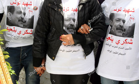 Tunisians Wearing T-shirts Bearing the Photo of Assassinated Opposition Leader Chokri Belaid Gather at His Tomb to Mark the 40-day Mourning Period at El-jellaz Cemetery in Tunis Tunisia 16 March 2013 the Assassination of Belaid Outside His Home in Tunis on 06 February Triggered Anti-government Protests and Forced Prime Minister Hamadi Jebali to Resign Tunisia Tunis