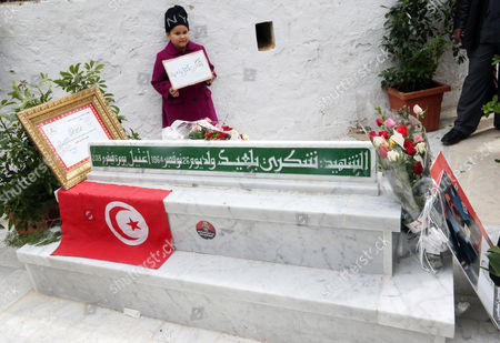 A Girl Holds a Banner Reading who Killed Chokri? at the Tomb of Assassinated Opposition Leader Chokri Belaid to Mark His 40-day Mourning Period at El-jellaz Cemetery in Tunis Tunisia 16 March 2013 the Assassination of Belaid Outside His Home in Tunis on 06 February Triggered Anti-government Protests and Forced Prime Minister Hamadi Jebali to Resign Tunisia Tunis