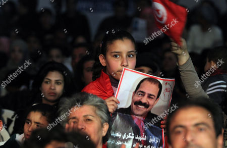 A Tunisian Girl Holds a Portrait Depicting Slain Opposition Leader Chokri Belaid During Ceremony Marking 40 Days Since His Killing in Tunis Tunisia 17 March 2013 the Assassination of Belaid Outside His Home in Tunis on 06 February Triggered Anti-government Protests and Forced Prime Minister Hamadi Jebali to Resign Tunisia Tunis