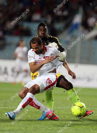 Tunisian Player Saber Khalifa (front) Fights For the Ball with Sierra Leone Goalkeeper Christian Caulker (behind) During Their World Cup 2014 Qualifying Soccer Match at Rades Stadium in Tunis Tunisia 13 March 2013 Tunisia Won 2-1 Tunisia Tunis