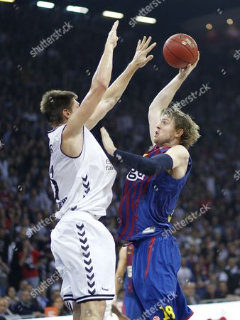 Barcelona Regal's C J Wallace (r) Tries to Basket Under Defence of Besiktas Istanbul's Gasper Vidmar (l) During Their Euroleague Group D Basketball Match in Istanbul Turkey 30 November 2012 L Turkey Istanbul