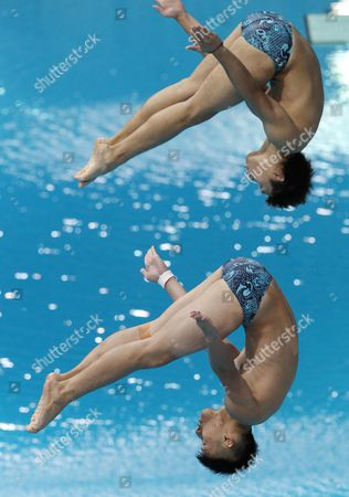 Third Placed Jason Wai Ching Poon and Ho Wing Chow of Hong Kong Compete in the Diving Men's 3m Synchro Springboard at the 9th Asian Swimming Championships at Hamdan Bin Mohammed Bin Rashid Sports Complex in Gulf Emirate of Dubai United Arab Emirates 22 November 2012 United Arab Emirates Dubai