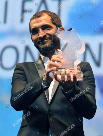 Egyptian Actor Amr Waked Holds His Award of Best Actor at Muhr Arab Feature For His Movie 'Winter of Discontent' During the Award Ceremony at the Closing Night of the 9th Dubai International Film Festival (diff) 2012 in Gulf Emirate of Dubai United Arab Emirates 16 December 2012 United Arab Emirates Dubai