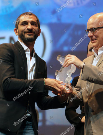 Egyptian Actor Amr Waked (l) Receives the Award For the Best Actor at Muhr Arab Feature For the Movie 'Winter of Discontent' During the Award Ceremony at the Closing Night of the 9th Dubai International Film Festival (diff) 2012 in Gulf Emirate of Dubai United Arab Emirates 16 December 2012 United Arab Emirates Dubai